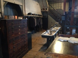Derbies and coats hung next to wash sink in Heavy Machinery Room.